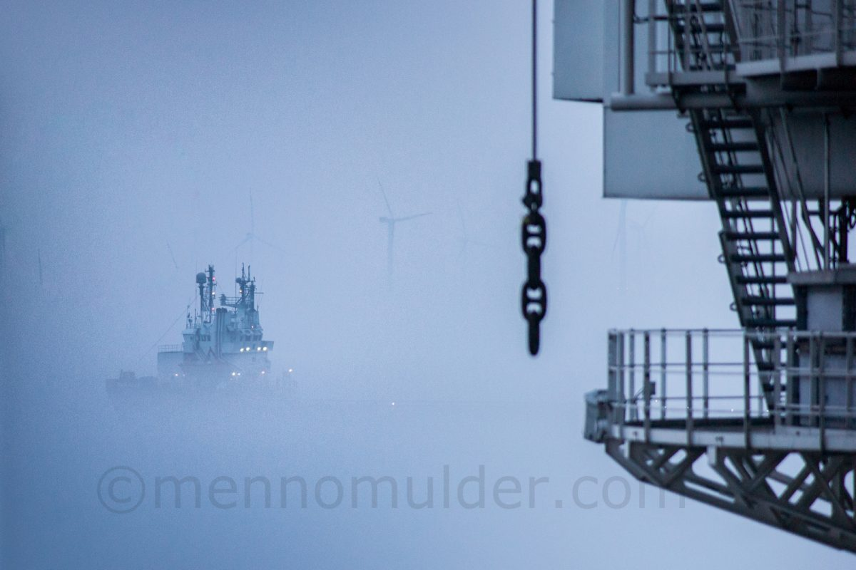 Supply vessel passing by in the early morning fog